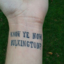"Tattoo reading ""Know ye now, Bulkington?"""