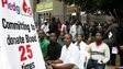 Thousands of Kenyans wait in line to donate blood on 22 September 2013 in Nairobi