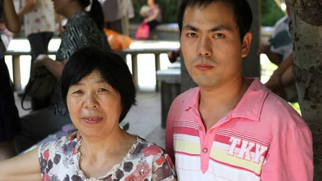 Zhang Junfei and his mother at a marriage market in Jade Lake Park Beijing