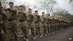 Members of the British military's 4th Mechanised Brigade parade through central London to attend a reception at the Houses of Parliament, Monday, April 22, 2013