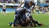 Millwall's players celebrate scoring against Leeds