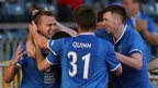 Linfield players Niall Quinn and Billy Joe Burns congratulate last-gasp goalscorer Peter Thompson at Windsor Park