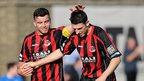 Colin Coates and Paul Leeman celebrate Crusaders' second goal against Glenavon