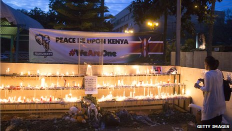 People light candles for the victims of the attack outside the Westgate Shopping Centre on 29 September 2013 in Nairobi, Kenya