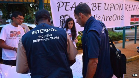 Interpol agents write messages outside Westgate on 29 September 2013 in Nairobi