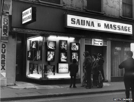 Men clustered outside a Soho sauna and massage parlour, 1973