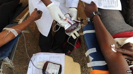 People donate blood on September 25, 2013 for victims of a deadly four-day siege that left more than 60 people dead and close to 200 injured after militants stormed the upmarket Westgate mall.
