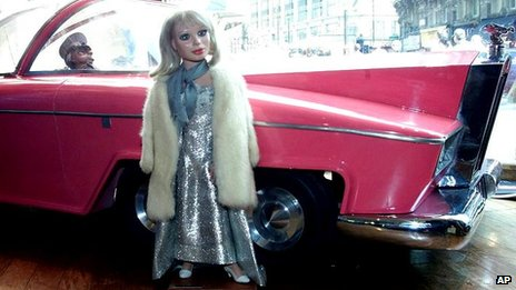 Two original Thunderbirds puppets, Lady Penelope and her chauffer Parker with FAB 1 the Rolls Royce are on display in a window in Central London