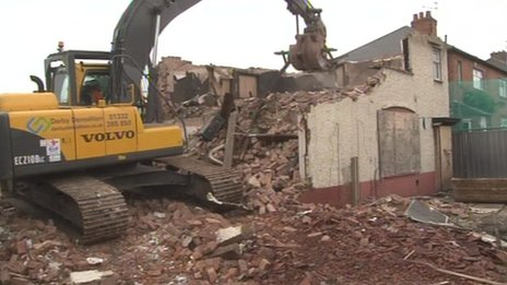 The house being demolished