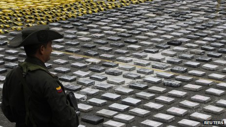 Cocaine seized from the criminal gang Los Urabenos is displayed by the Colombian police on 20 April, 2013