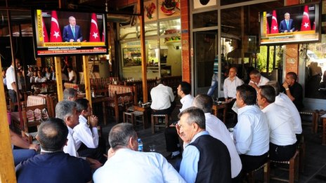 Kurds watch Turkish PM Erdogan announcing reforms