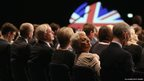 Delegates listen to speeches in the main hall on the second day of the Conservative Party Conference in Manchester, England