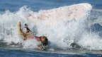 Dog falls off surf board