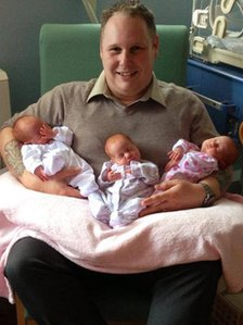 Ian Gilbert with his triplets
