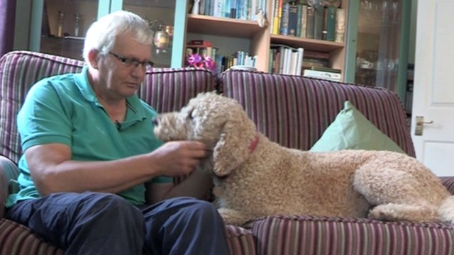 Peter Lewin and his pet labradoodle, Bentley