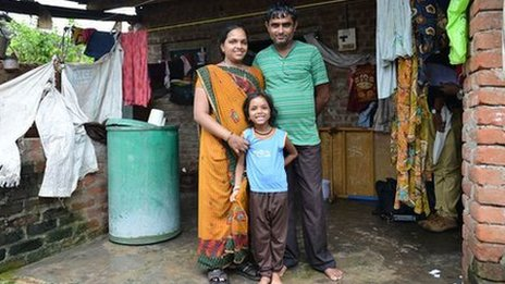 Vasanti and her husband Ashok with their daughter