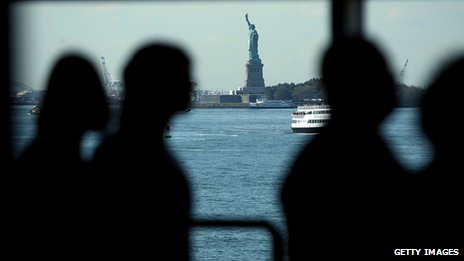 Shadow people and statue of liberty