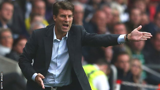 Swansea manager Michael Laudrup pleads with his team from the touchline at the Liberty Stadium