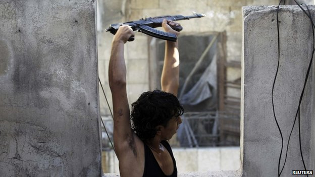 A Free Syrian Army fighter fires his weapon towards snipers loyal to Syria's President Bashar al-Assad in the Aleppo district of Salaheddine, 30 September, 2013.
