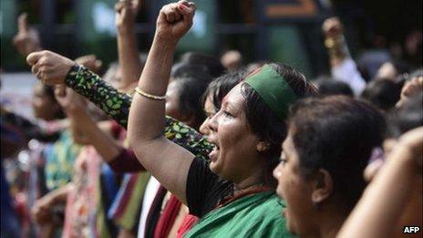 Bangladeshi social activists shout slogans in celebration outside the International Crimes Tribunal court in Dhaka on October 1, 2013