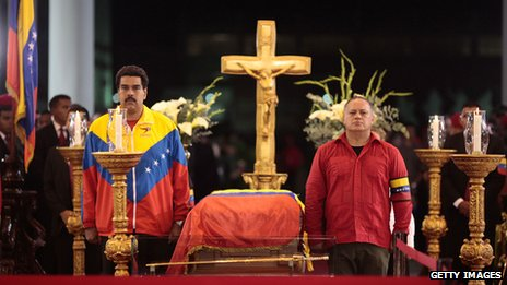 Nicolas Maduro (left) and Diosdado Cabello stand next to the coffin of late Venezuelan President Hugo Chavez