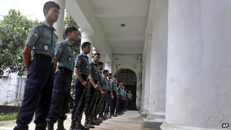 Police stand guard outside the tribunal in Dhaka on 1 October
