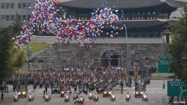 "South Korean troops attend a military parade in front of Namdaemun, officially called Sungnyemun, or ""Great South Gate"" during a ceremony to mark the 65th anniversary of Armed Forces Day on the street in central Seoul 1 October 2013"