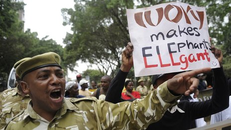 A Kenya Wildlife Service rangers leads a group of wildlife conservationists during a protest in Nairobi on 29 June 2013
