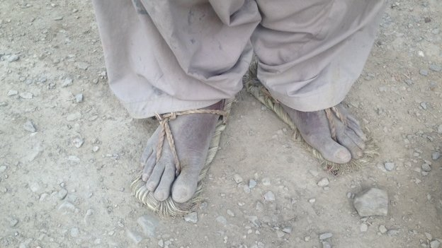 Dusty feet of a villager in remote Balochistan village