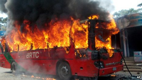 A bus set on fire in Chittagong by activists of the opposition Bangladesh Nationalist Party (BNP) in protest against Salauddin Quader Chowdhury's death sentence