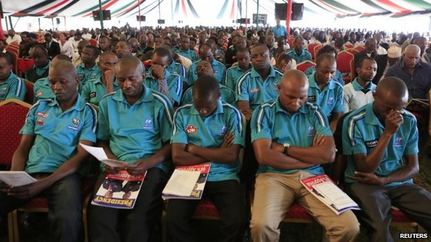 Workers from Nakumatt supermarket within the Westgate shopping mall attend a special inter-religious prayer service for colleagues and the people killed and injured in the recent attack in the capital Nairobi on Tuesday