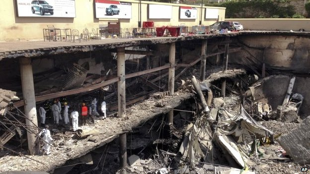 Forensics investigators work next to the collapsed upper car park at the Westgate Mall in Nairobi, Kenya on Tuesday