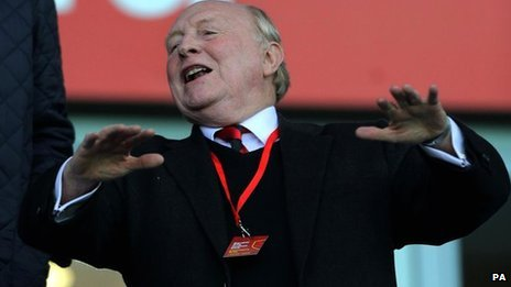 Lord Kinnock celebrating at a football match