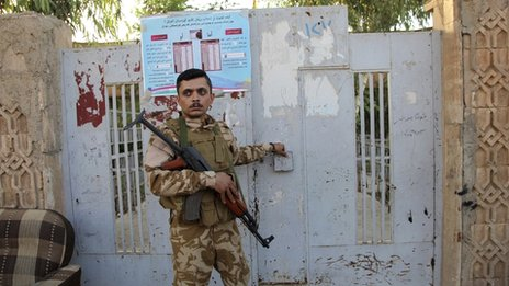Guarding a polling station in Erbil, Sept 2013