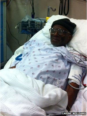 Herman Wallace in a hospital bed
