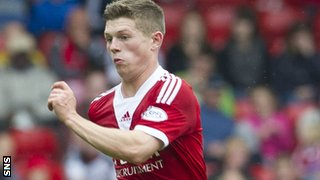 Aberdeen's 18-year-old midfielder Cammy Smith scored in the League Cup against Falkirk