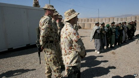 File photo: Australian soldiers, part of the International Security Assistance Force (Isaf), stand near local Afghans at a ceremony to open a Trade Training School at the Tarin Kowt military base in Uruzgan province, south of Kabul, Afghanistan, 17 February 2007