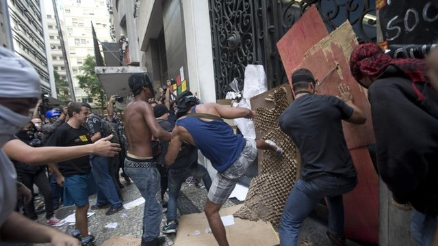 Protestors kick the door of City Hall during a teachers strike in Rio de Janeiro, Brazil