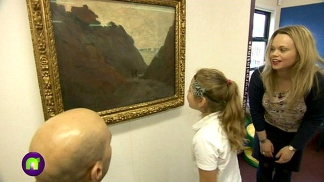 A girl looks at art by Monet