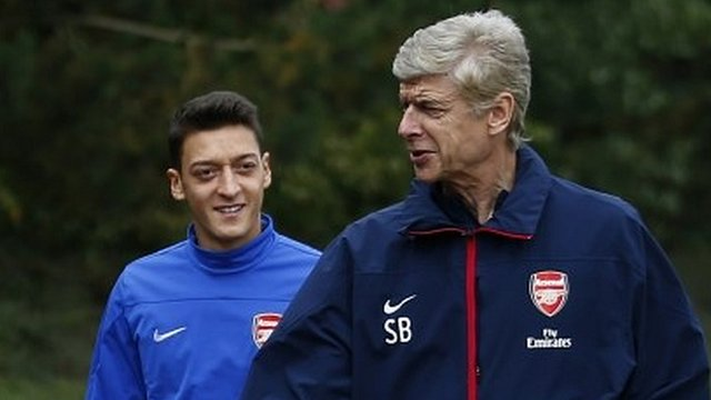 Arsene Wenger and Mesut Ozil