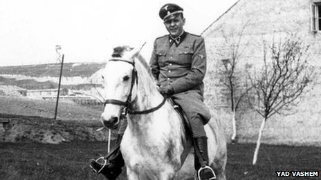 Amon Goeth in uniform, riding a horse