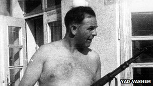 Amon Goeth holding a gun