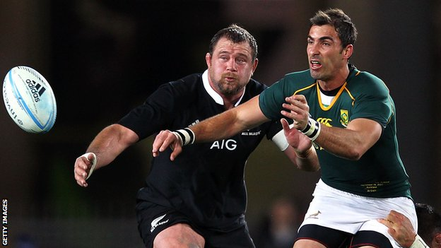 Ruan Pienaar battles with New Zealand's Tony Woodcock in the recent Rugby Championship clash