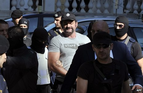 Yiannis Lagos under police escort in Athens, 1 October 2013