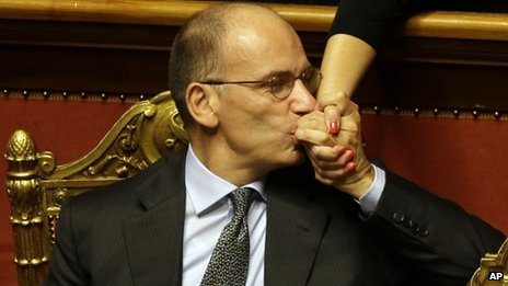 Italian Premier Enrico Letta kisses the hand of an unidentified senator after delivering his speech at the Senate