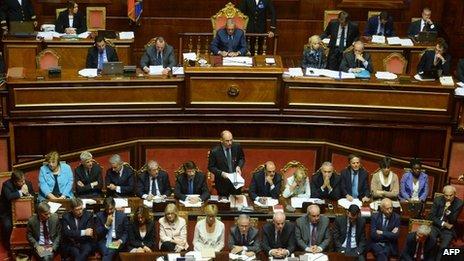 Prime Minister Enrico Letta (C) delivers a speech to the Senate