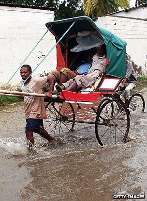 Rickshaw in flooded street in Madagascar
