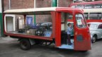 Boy driving milk float