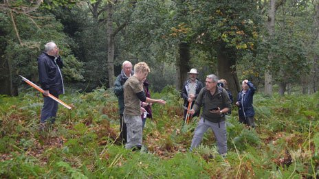 Steve Fisher with the volunteers surveying an inclosure