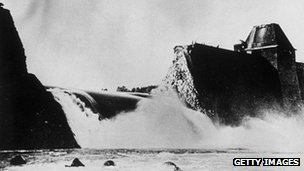Water pouring through the ruins of a dam (black and white picture from 1943)